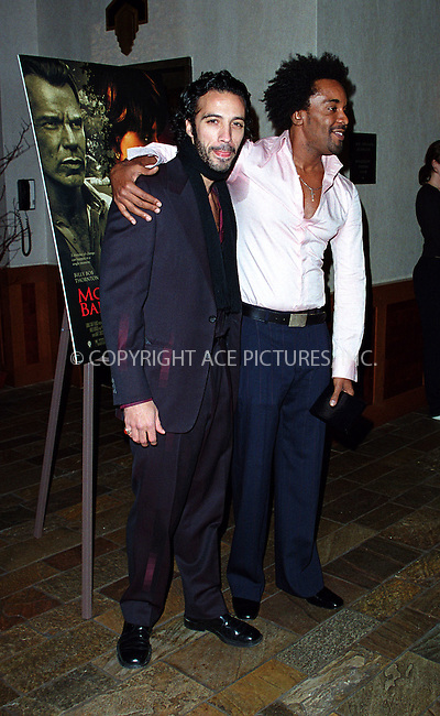 """*WORLD SYNDICATION RIGHTS*..Producer Lee Daniels hosting special charity screening of """"Monster's Ball"""" at the Tribeca Grand Hotel in New York. Picture shows Carlos Leon and Lee Daniels. December 20, 2001. © 2001 by Alecsey Boldeskul...ONE-TIME REPRODUCTION RIGHTS..HI RES SCAN AVAILABLE UPON REQUEST"""