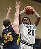 Tre Riggins #20 of Baldwin, right, shoots from short range as Connor Payne #35 of Massapequa tries to contest his shot during the Nassau County varsity boys basketball Class AA semifinals at Farmingdale State College on Monday, Feb. 26, 2018. Baldwin won by a score of 50-41.