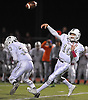 Mepham quarterback No. 10 Michael Proios throws a pass for a completion during a Nassau County Conference II varsity football game against Long Beach at Long Beach Middle School on Friday, October 16, 2015. Mepham led 14-0 at halftime.<br /> <br /> James Escher