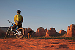 A mountain biker takes in the sunset while riding in Sedona, Arizona.