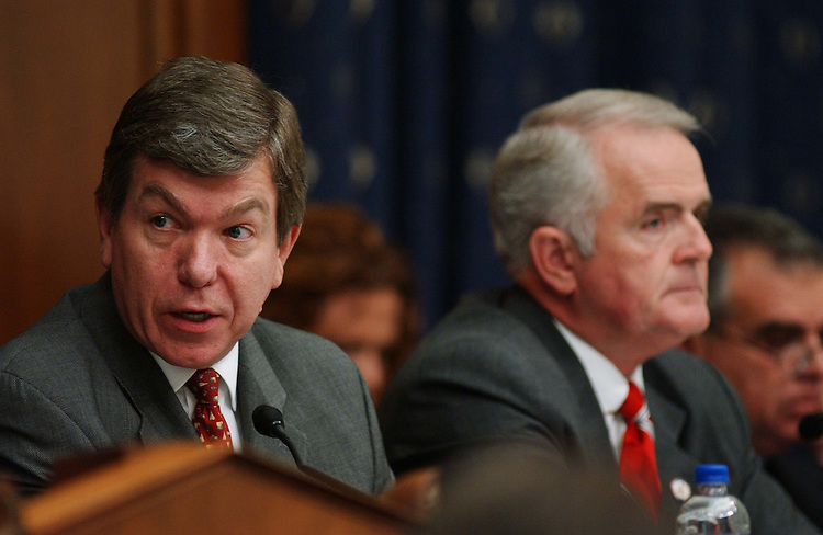 "9/29/04.INTELLIGENCE RESTRUCTURING--Roy Blunt, R-Mo., and Jim Gibbons, R-Nev., during the House Select Intelligence markup of draft legislation, HR 10, the ""9/11 Recommendations Implementation Act,"" which would reorganize and restructure U.S. intelligence gathering and analysis operations..CONGRESSIONAL QUARTERLY PHOTO BY SCOTT J. FERRELL"