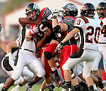 BRANDON, SD - SEPTEMBER 26: Alex Wilde #15 from Brandon Valley bulls his way through Michael Enalls #25 from Washington in the first quarter of their game Friday night in Brandon.  (Photo by Dave Eggen/Inertia)