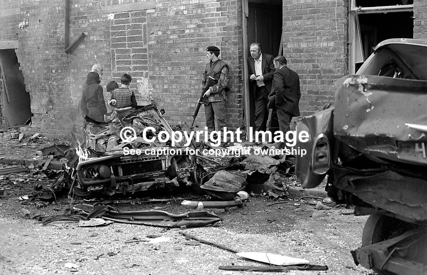 British soldier on duty at scene of car bomb explosion in Dunlewey Street, Belfast, N Ireland. Thirty four people were injured, 2 critically, in the attack which was seen as a reprisal for the bombing of the Bayardo Bar in the loyalist Shankill Road area some days earlier in which 4 people died and around 60 were injured. 197508150593a..Copyright Image from Victor Patterson, 54 Dorchester Park, Belfast, United Kingdom, UK...For my Terms and Conditions of Use go to http://www.victorpatterson.com/Victor_Patterson/Terms_%26_Conditions.html