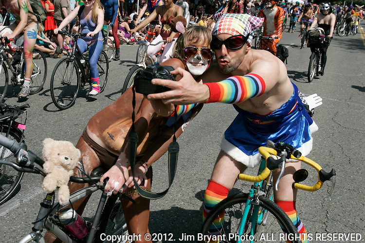 Two painted nude bicyclists take their picture during the 25th  Annual Fremont Summer Solstice Parade in Seattle on June 22, 2013.    UPI Photo/Jim BryantPainted nude bicyclists  ride during the 25th  Annual Fremont Summer Solstice Parade in Seattle on June 22, 2013.     ©2013.  Jim Bryant.  ALL RIGHTS RESERVED.