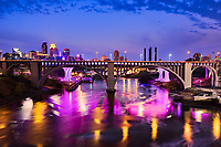 Colorful lights of the Interstate 35W bridge reflected in the Mississippi River at Minneapolis, Minnesota.