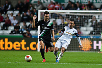 Thursday  03 October  2013  Pictured:Leon Britton of Swansea gets the ball past Goran Karanovic of St.Gallen<br /> Re:UEFA Europa League, Swansea City FC vs FC St.Gallen,  at the Liberty Staduim Swansea