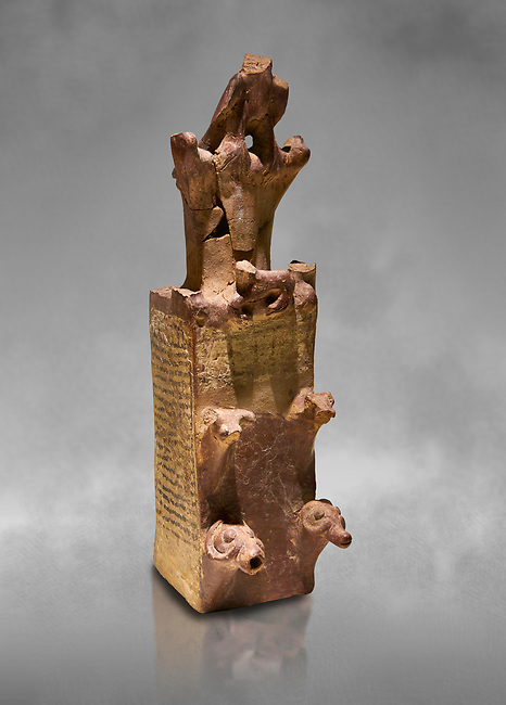Hittite terra cotta tower shaped vessel representing a two storey tower of the city walls complete with merlons - 14th century BC - Hattusa ( Bogazkoy ) - Museum of Anatolian Civilisations, Ankara, Turkey . Against grey art background