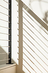Graphic image of shadows from a metal railing in a contemporary home. This image is available through an alternate architectural stock image agency, Collinstock located here: http://www.collinstock.com