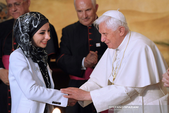 Pope Benedict XVI is cheered by wellwishers during his visit to the Lady of Peace Church in Amman, Jordan Friday, May 8, 2009.