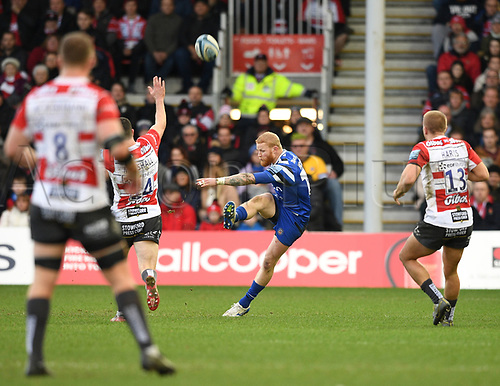 4th January 2020; Kingsholm Stadium, Gloucester, Gloucestershire, England; English Premiership Rugby, Gloucester versus Bath; Tom Homer of Bath clears the ball under pressure from Chris Harris and Tom Marshall of Gloucester - Editorial Use