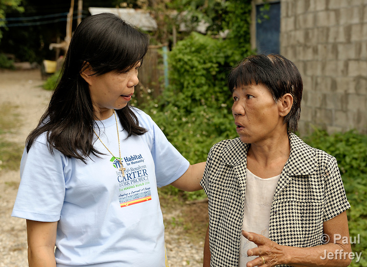 Jaruwan Wutti (left), the manager of the AIDS Ministry of the Church of Christ in Thailand, visits with Pranom Kantawong, a woman living with HIV in the city of Chiang Mai in northern Thailand.
