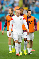 Wayne Rooney of England warms up with his team mates Glen Johnson , Leighton Baines and Jordan Henderson