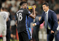CARSON, CA - SEPTEMBER 21: Orji Okwonkwo #18 of the Montreal Impact has some water as head coach Wilmer Cabrera has a few words for him during a game between Montreal Impact and Los Angeles Galaxy at Dignity Health Sports Park on September 21, 2019 in Carson, California.