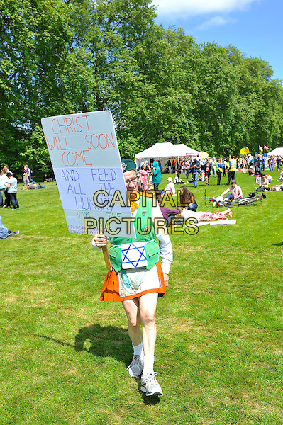 Fan<br /> attending The Big IF, Hyde Park, London, England. <br /> 8th June 2013<br /> full length brown costume gv general view concert goer sign christ will soon come and feed all the hungry says the bible<br /> CAP/MAR<br /> &copy; Martin Harris/Capital Pictures