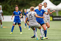 Seattle, WA - Sunday, August 13, 2017: Jaelene Hinkle, Lindsay Elston during a regular season National Women's Soccer League (NWSL) match between the Seattle Reign FC and the North Carolina Courage at Memorial Stadium.