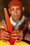 Retrato de &iacute;ndio Kalapalo arrumando Tucanap (cocar) para festa do Kuarup na Aldeia Aiha no Parque Ind&iacute;gena do Xingu | Portrait of Kalapalo man arranging Tucanap (headdress) to Kuarup party at Aiha Village in the Xingu Indigenous Park<br /> <br /> LOCAL: Quer&ecirc;ncia, Mato Grosso, Brasil <br /> DATE: 07/2009 <br /> &copy;Pal&ecirc; Zuppani