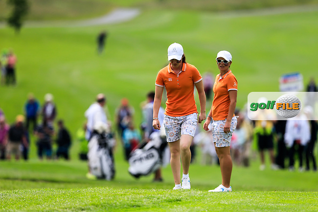 A view over the 18th with Charlotte Thomas and Leona Maguire during the Saturday morning foursomes at the 2016 Curtis cup from Dun Laoghaire Golf Club, Ballyman Rd, Enniskerry, Co. Wicklow, Ireland. 11/06/2016.<br /> Picture Fran Caffrey / Golffile.ie<br /> <br /> All photo usage must carry mandatory copyright credit (&copy; Golffile | Fran Caffrey)