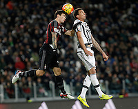 Calcio, Serie A: Juventus vs Milan. Torino, Juventus Stadium, 21 novembre 2015. <br /> AC Milan&rsquo;s Alessio Romagnoli, left, and Juventus&rsquo; Mario Mandzukic jump for the ball during the Italian Serie A football match between Juventus and AC Milan at Turin's Juventus stadium, 21 November 2015. Juventus won 1-0.<br /> UPDATE IMAGES PRESS/Isabella Bonotto