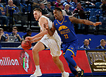 SIOUX FALLS, SD - NOVEMBER 28: Mike Daum #24 from South Dakota State University pushes the ball past Brandon Suggs #22 from UMKC during their game Wednesday night at Frost Arena in Brookings, SD. (Photo by Dave Eggen/Inertia)