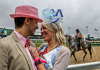 LOUISVILLE, KENTUCKY - MAY 04: Bryn Turner (R) reacts after accepting a marriage proposal from her now-fiancé Michael Taday while celebrating Thurby in the rain at Churchill Downs on May 4, 2017 in Louisville, Kentucky. (Photo by Jesse Caris/Eclipse Sportswire/Getty Images)
