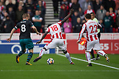 30th September, bet365 Stadium, Stoke-on-Trent, England; EPL Premier League football, Stoke City versus Southampton; Stoke City's Mame Biram Diouf and Southampton's Steven Davis fight over a ball