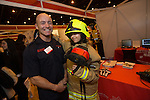 Skills Active Cymru<br /> Danielle Phillips from Bedwas High School with a South Wales fire officer.<br /> <br /> Cardiff International Arena<br /> 23.10.14<br /> &copy;Steve Pope-FOTOWALES