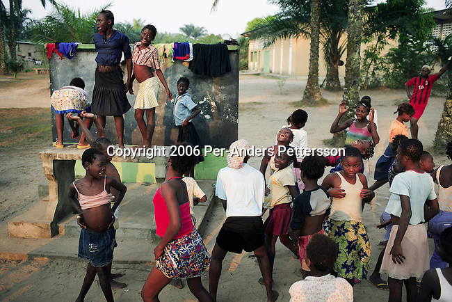 KINSHASA, DEMOCRATIC REPUBLIC OF CONGO - JULY 6: Street children dance to Congolese music at a yearly summer camp run by Orper, a local NGO on July 6, 2006 in N Djili outside Kinshasa, Congo, DRC. The NGO has several shelters for homeless boys and girls in Kinshasa and has a program that reunites children with their families. The capital has a growing problem with children displaced by war, poverty and many has been rejected by their families and forced on the streets. About 15,000 children are estimated to live on the streets of Kinshasa. About fifty girls got to spend a week relaxing, playing, swimming eating three meals a day. Most important of all, it took them off the hard streets of Kinshasa, where they are often abused, take drugs and forced into prostitution. Esther has lived on the streets for a few years and run away from her family. She abuse drugs, alcohol and works as prostitute. Congo, DRC is in ruins after forty years of mismanagement by the corrupt dictator and former president Mobuto Sese Seko. He fled the country in 1997 and a civil war started. The country is planning to hold general elections by July 2006, the first democratic elections in forty years. (Photo by Per-Anders Pettersson)
