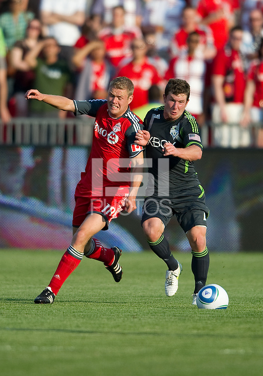 Seattle Sounders FC midfielder Mike Fucito #2 and Toronto FC forward Nick Soolsma #18 in action during an MLS game between the Seattle Sounders FC and the Toronto FC at BMO Field in Toronto on June 18, 2011..The Seattle Sounders FC won 1-0.