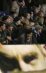 Birmingham City 0 Liverpool 7, 21/03/2006. St Andrews, FA Cup 6th Round. Birmingham City (blue) versus Liverpool,  The home side lost 0-7. Picture shows a City fans relays the bad news by mobile phone. Photo by Colin McPherson.