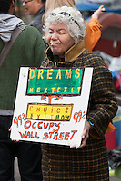 A woman holds a protest sign in Zuccotti Park during the Occupy Wall Street demonstration in New York City, New York.