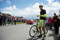 Andrea Fedi (ITA/Neri Sottoli) is stuck with an exploded tube by the side of the road, waiting for his teamcar to get him going again.<br /> <br /> Giro d'Italia 2014<br /> stage 3: Armagh - Dublin 187km