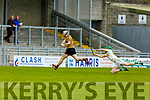 Kerry Padraig Boyle lets fly to raise the green flag as  Offaly's Eoin Parton attempts to hook him in the Joe McDonagh Cup relegation game in Tralee on Saturday.