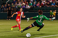 Western New York Flash midfielder Carli Lloyd (10) beats Portland Thorns goalkeeper Karina LeBlanc (1) but her shot goes wide of the net. The Portland Thorns defeated the Western New York Flash 2-0 during the National Women's Soccer League (NWSL) finals at Sahlen's Stadium in Rochester, NY, on August 31, 2013.