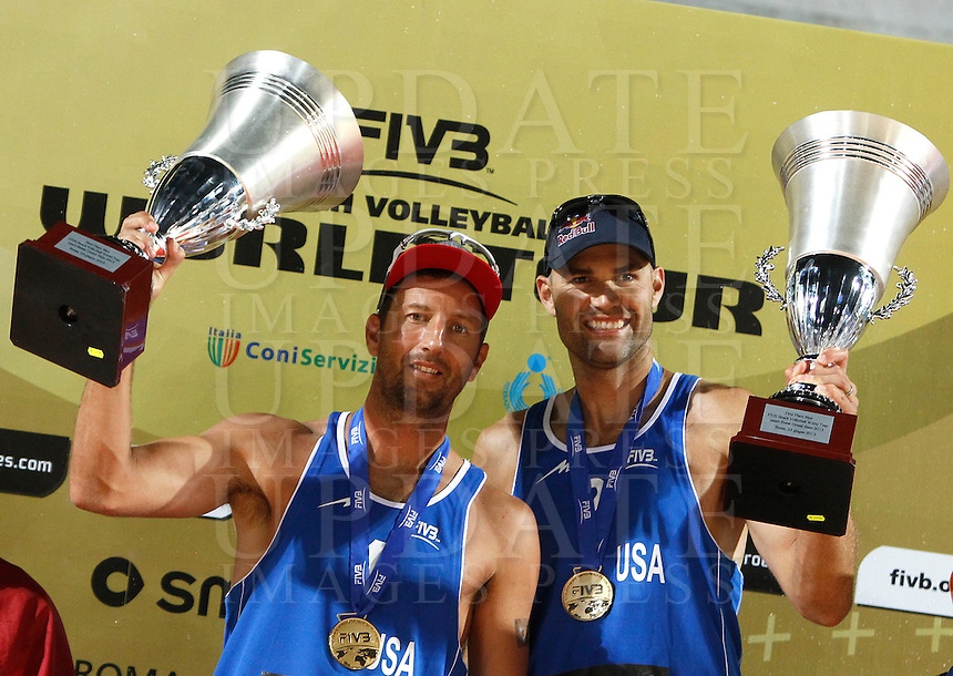 Sean Rosenthal, left, and Phil Dalhausser, of the United States, hold their trophies after winning the men's final match between Usa and Latvia at the Beach Volleyball World Tour Grand Slam, Foro Italico, Rome, 23 June 2013. USA defeated Latvia 2-0.<br /> UPDATE IMAGES PRESS/Isabella Bonotto