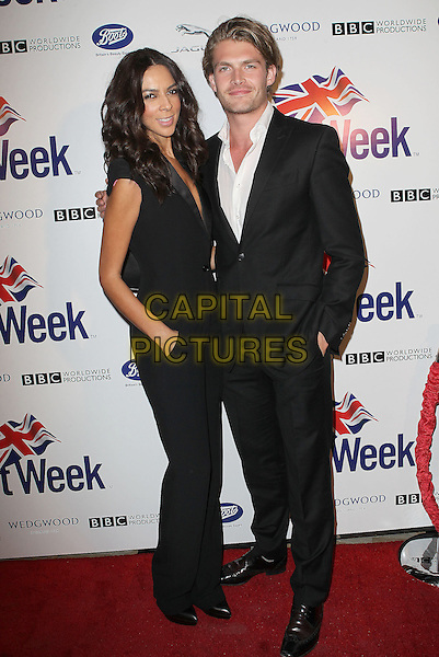 "Terri Seymour and Clark Mallon.7th Annual BritWeek Festival ""A Salute To Old Hollywood"" Launch Party held at the British Consul General's Residence, Los Angeles, California, USA..April 23rd, 2013.full length black catsuit jumpsuit plunging neckline suit white shirt couple hand in pockets side.CAP/ADM/KB.©Kevan Brooks/AdMedia/Capital Pictures"
