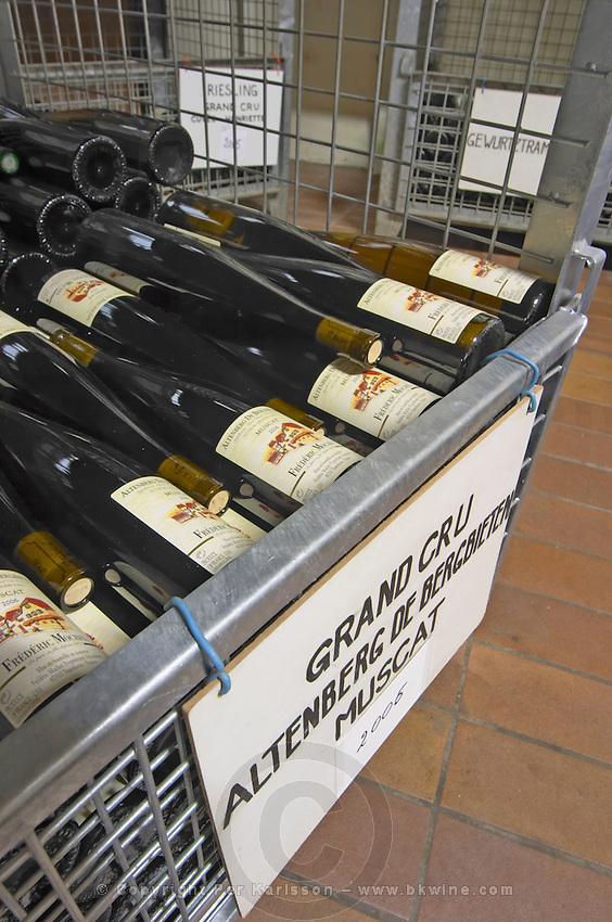 muscat bottles stored in wire cages altenberg de bergbieten gc dom frederic mochel traenheim alsace france