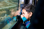 A young Palestinian child peers out of a service taxi window at the projected route of Israel's controversial separation barrier between the Israeli settlement of Efrat (Efrata) & the Palestinian village of Wad Rahal while en route to the city of Bethlehem on 28/06/2010.