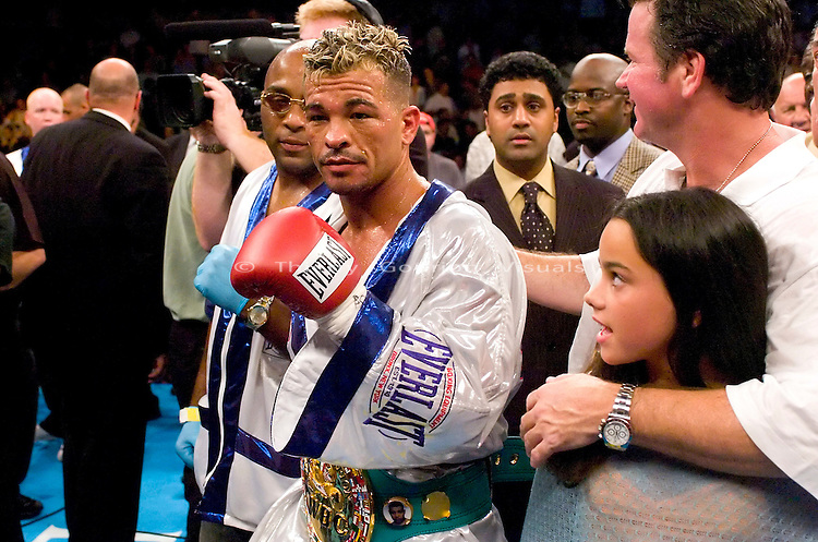 Arturo Gatti (center) poses in the ring after his fight against Leonard Dorin for the WBC Super Lightweight Championship at the Boardwalk Hall in Atlantic City, New Jersey on July 24, 2004. Gatti won the fight by KO in the 2nd Round with a left body shot to the body. Photo by Thierry Gourjon.
