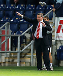 Aberdeen manager Mark McGhee gestures from the sideline