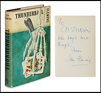 """BNPS.co.uk (01202)558833<br /> Pic:  SwannAuctionGalleries/BNPS<br /> <br /> A first edition of Thunderball (1961), expected to fetch £9,300 ($12,000).    It carries the inscription: """"To C.D. Jackson who says nice things! from Ian Fleming.""""<br /> <br /> A single owner collection of historic James Bond first editions inscribed by Ian Fleming have emerged for sale for £55,000. ($70,000)<br /> <br /> The marquee lot is a first edition of Goldfinger (1959) given by the author to legendary golfer Sir Henry Cotton, who won The Open three times.<br /> <br /> Fleming references the chapters containing the classic golf match between Bond and the villain Auric Goldfinger, whose caddy was Oddjob, in the book.<br /> <br /> The collection of 13 books is being sold by a private collector with US based Swann Auction Galleries."""
