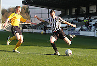 Sean Kelly crossing as he is closed down by Liam Rowan in the St Mirren v Falkirk Clydesdale Bank Scottish Premier League Under 20 match played at St Mirren Park, Paisley on 30.4.13. .