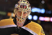 Boston, MA - Boston Bruins goalie Tuukka Rask gazes out from behind his mask during warmups for a game against the Ottawa Senators at TD Garden on Tuesday, February 28, 2012.
