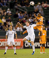 Puerto Islanders Christopher Nurse (8) leaps high over LA Galaxy midfielder Chris Birchall (11) beats  headball. The Puerto Rico Islanders defeated the LA Galaxy 4-1 during CONCACAF Champions League group play at Home Depot Center stadium in Carson, California on Tuesday July 27, 2010.