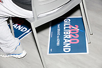 Campaign signs lay on the ground in the audience as Democratic presidential candidate Senator Kirsten Gillibrand (D-NY) speaks at a town hall campaign event at the Concord Parks and Recreation Community Center in Concord, New Hampshire, USA on Sat., Apr. 6, 2019.
