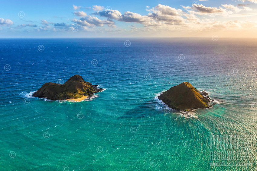An aerial view of the Mokulua Islands, as seen during a morning helicopter tour over Windward O'ahu.