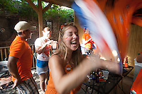 New Orleans, LA - Saturday, July 5, 2014: Dutch fans react  to winning the Netherlands vs. Costa Rica World Cup quarterfinal match at the Rusty Nail.