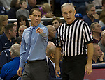 Nevada's head coach Eric Musselman talks with a referee against Colorado State in the first half of an NCAA college basketball game in Reno, Nev., Sunday, Feb. 25, 2018. (AP Photo/Tom R. Smedes)