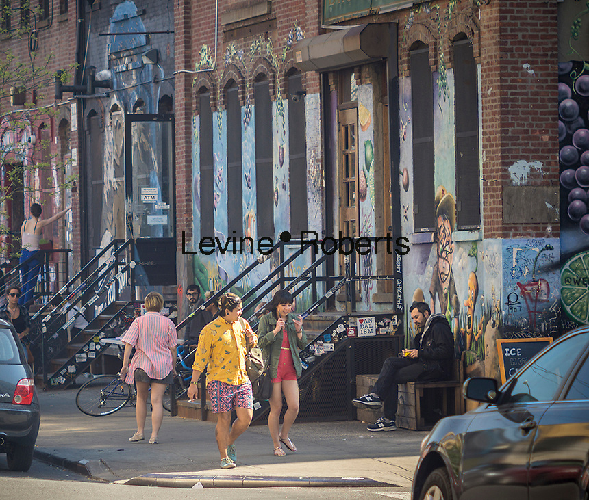 Activity along Bogart Avenue in the Bushwick neighborhood of Brooklyn in New York on Saturday, April 27, 2013. The neighborhood is undergoing gentrification changing from a rough and tumble mix of Hispanic and industrial to a haven for hipsters, forcing many of the long-time residents out because of rising rents.. (© Richard B. Levine)