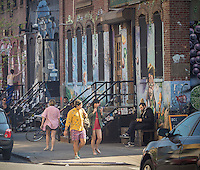 Activity along Bogart Avenue in the Bushwick neighborhood of Brooklyn in New York on Saturday, April 27, 2013. The neighborhood is undergoing gentrification changing from a rough and tumble mix of Hispanic and industrial to a haven for hipsters, forcing many of the long-time residents out because of rising rents.. (©Richard B. Levine)