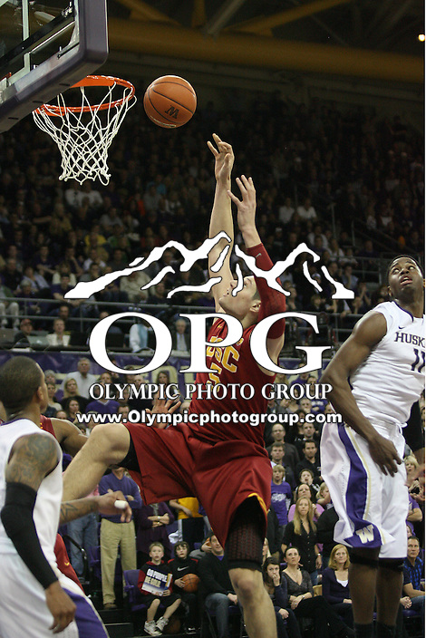 Mar 05, 2011:  USC's #5 Nikola Vucevic goes up for a put back basket against Washington.  USC defeated Washington 62-60 at Alaska Airlines Arena Seattle, Washington...